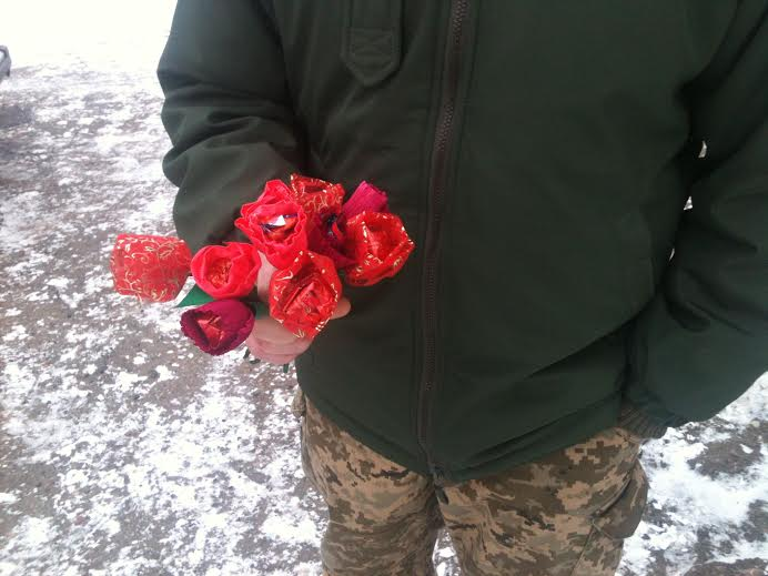 квіти в руках